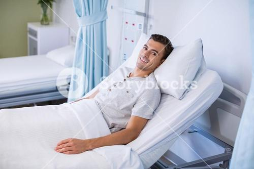 Portrait of patient lying on bed in a hospital