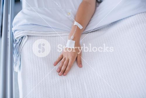 Boy patient hand injected with saline iv drip