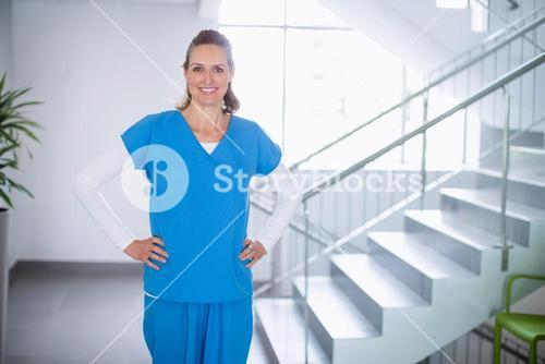 Portrait of doctor standing with hands on hip