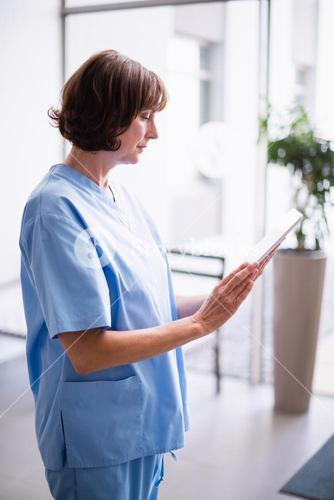 Nurse using digital tablet