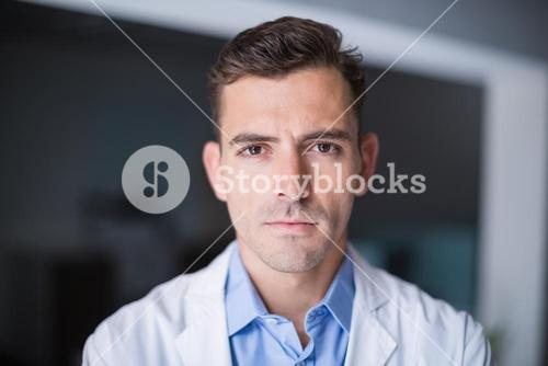 Portrait of thoughtful doctor