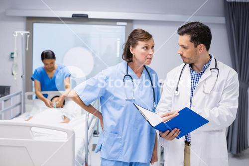 Doctors discussing with patient report