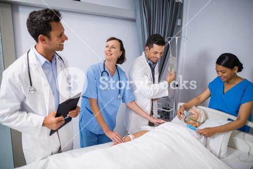 Doctors examining senior patient