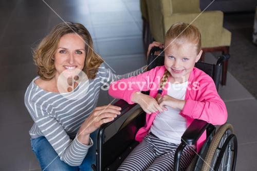 Portrait of smiling woman and disabled girl