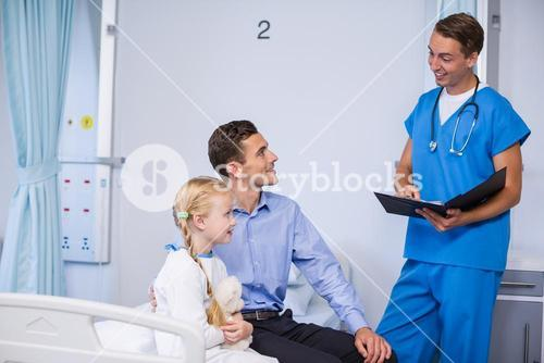 Doctor interacting with sick girl and man