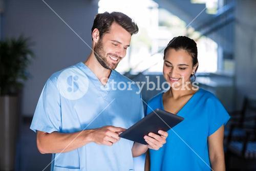 Doctors using digital tablet