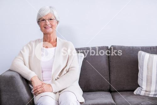 Portrait of senior woman sitting on sofa