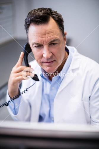 Male doctor interacting on phone