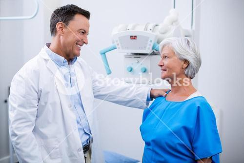 Doctor interacting with senior woman during medical check-up