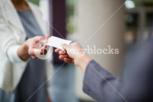 Business executives exchanging business card