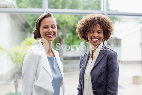 Cheerful business executives at conference centre