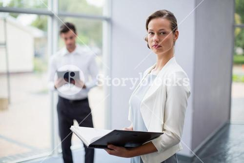 Businesswoman holding a file at conference centre