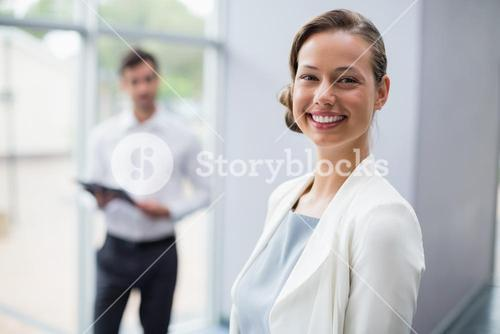 Cheerful businesswoman at conference centre