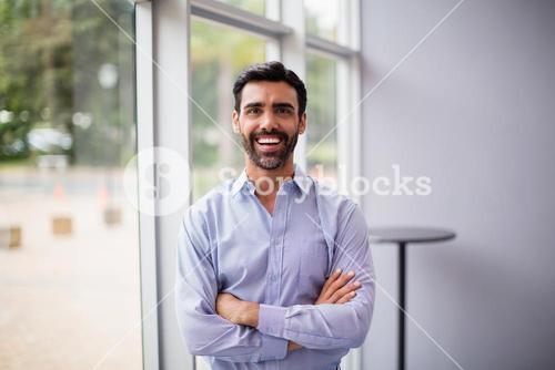 Cheerful businessman at conference centre