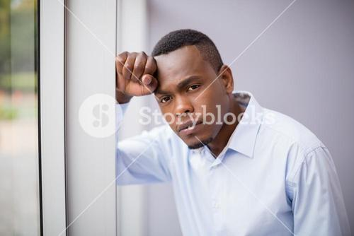 Stressed businessman at conference centre