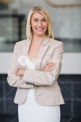 Happy businesswoman standing in conference centre