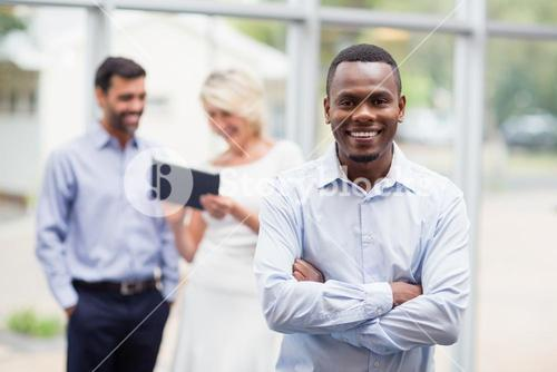 Happy businessman standing in conference centre