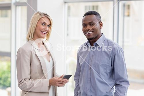 Happy business executives at conference centre
