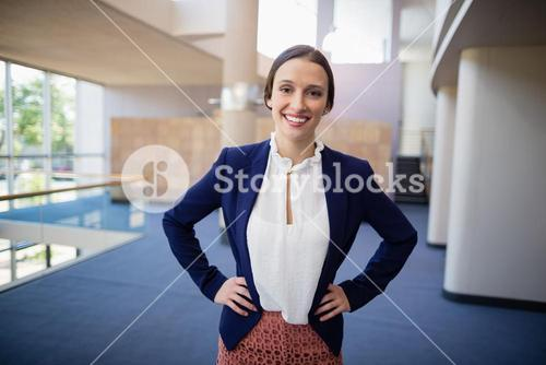 Happy businesswoman with arms crossed