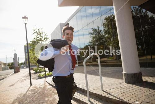Excited businessman running