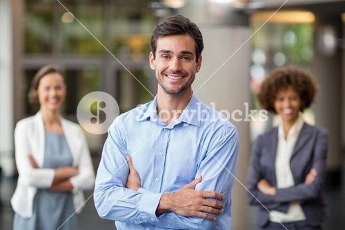 Portrait of happy business executive with arms crossed