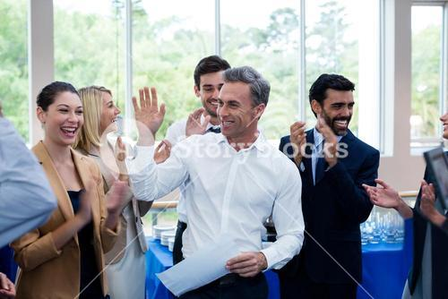 Happy business executives giving high five