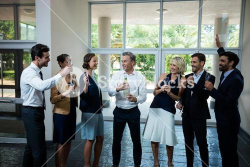 Business executives celebrating at conference center