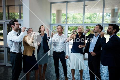 Business executives having champagne at conference center