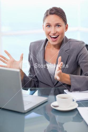 Portrait of a surprised businesswoman working with a notebook