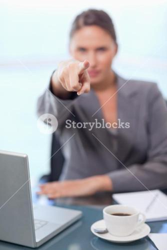 Portrait of a businesswoman pointing at the viewer