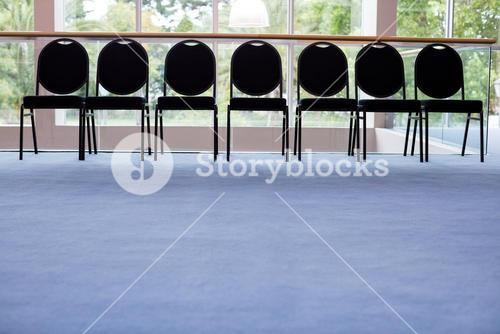 Empty chairs in lobby at conference center
