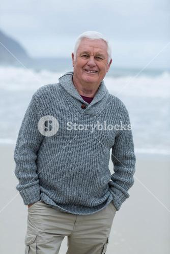 Portrait of senior man standing on the beach