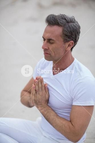 Mature man doing meditation