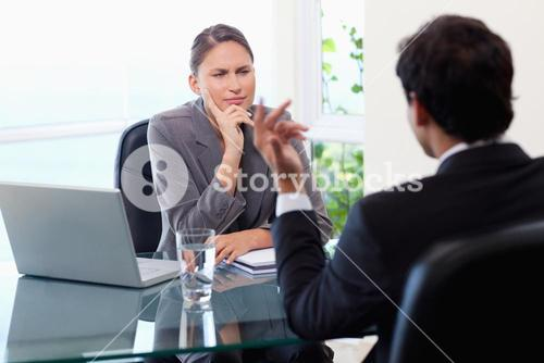 Businesswoman listening to her customer closely