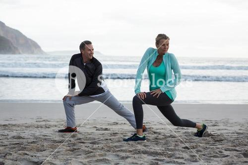 Mature couple doing stretching exercise