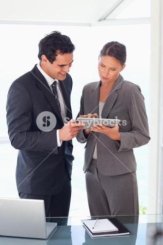 Business partner looking at tablet together