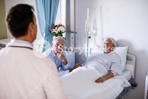 Senior patient interacting with doctor