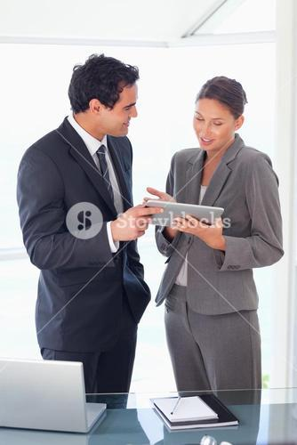 Business partner looking at tablet in their hands
