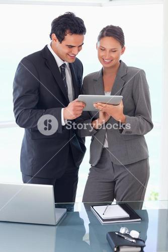 Trades partner looking at tablet in their hands
