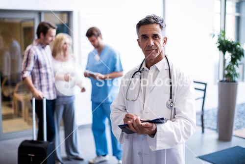 Portrait of smiling doctor holding a clipboard