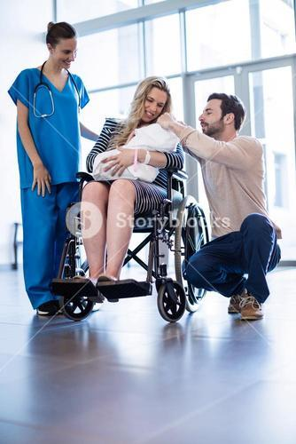 Couple looking at their newborn baby