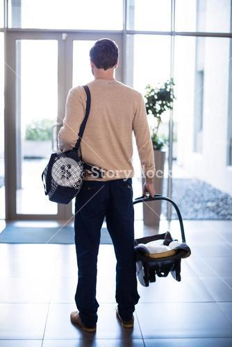 Man leaving the hospital with baby