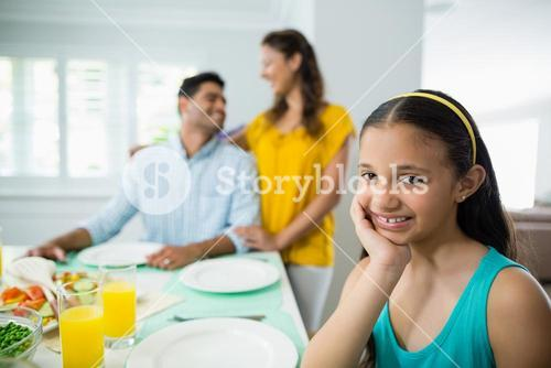 Portrait of girl sitting at dining table