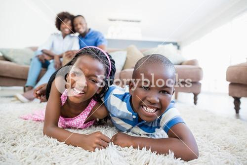 Siblings playing in living room