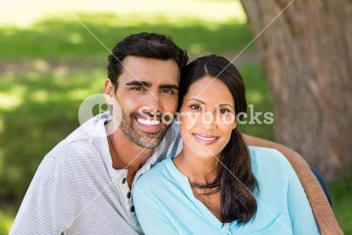 Portrait of couple sitting together in a park