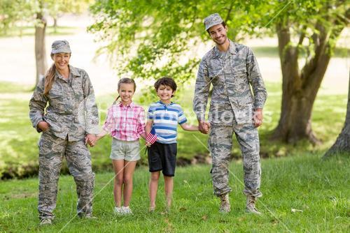 Military couple with their kids