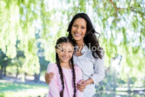 Mother standing with her daughter in park