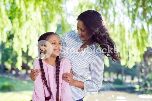 Mother having fun with her daughter in park