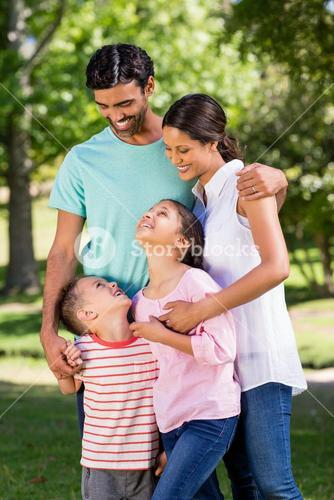Happy family standing in park