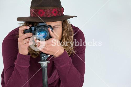 Photographer clicking a picture using digital camera